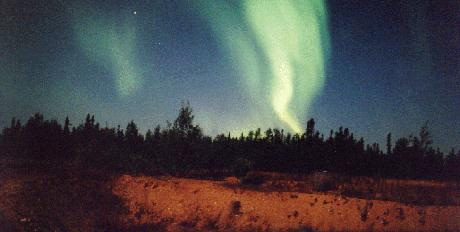 Auroral curtain reaching down to horizon photo